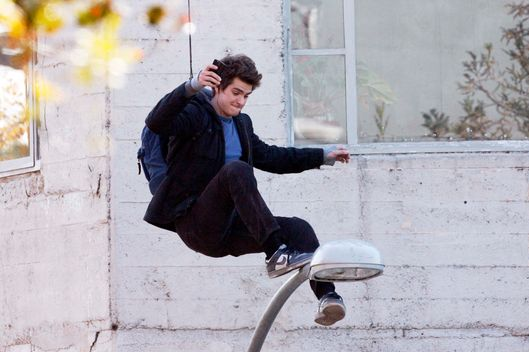 Andrew Garfield is seen on the set of Spider-Man in downtown Los Angeles. He does a scene on top of a light pole, making faces and doing some texting as he waits for cameras to roll. <P> Pictured: Andrew Garfield <P> <B>Ref: SPL341826  081211  </B><BR/> Picture by: PhamousFotos / Splash News<BR/> </P><P> <B>Splash News and Pictures</B><BR/> Los Angeles:	310-821-2666<BR/> New York:	212-619-2666<BR/> London:	870-934-2666<BR/> photodesk@splashnews.com<BR/> </P>