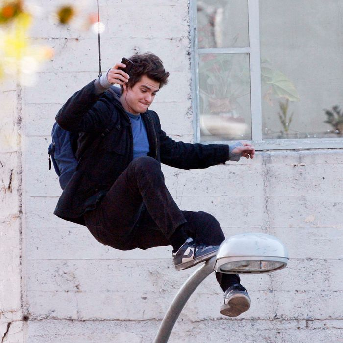 Andrew Garfield is seen on the set of Spider-Man in downtown Los Angeles. He does a scene on top of a light pole, making faces and doing some texting as he waits for cameras to roll. <P> Pictured: Andrew Garfield <P> <B>Ref: SPL341826 081211 </B><BR/> Picture by: PhamousFotos / Splash News<BR/> </P><P> <B>Splash News and Pictures</B><BR/> Los Angeles:310-821-2666<BR/> New York:212-619-2666<BR/> London:870-934-2666<BR/> photodesk@splashnews.com<BR/> </P>