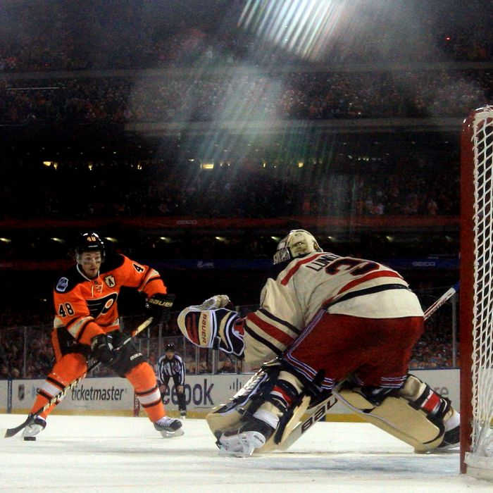 PHILADELPHIA, PA - JANUARY 02: Henrik Lundqvist #30 of the New York Rangers makes a save on a penalty shot by Danny Briere #48 of the Philadelphia Flyers late in the third period during the 2012 Bridgestone NHL Winter Classic at Citizens Bank Park on January 2, 2012 in Philadelphia, Pennsylvania. (Photo by Rob Carr/Getty Images)