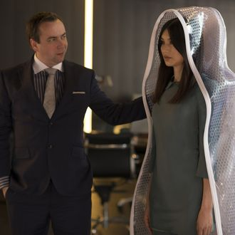Dan Tetsell as Salesman and Gemma Chan as Anita - Humans _ Season 1, Episode 1 - Photo Credit: Des Willie/Kudos/AMC/C4
