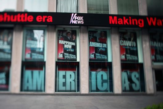 "The Fox News ticker is displayed outside News Corp. headquarters in New York, U.S., on Tuesday, July 19, 2011. Rupert Murdoch defended News Corp.'s reputation over the phone-hacking scandal at his News of the World tabloid before U.K. lawmakers on what he told them was ""the most humble day of my life."" Photographer: Stephen Yang/Bloomberg via Getty Images"