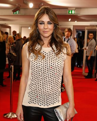BERLIN, GERMANY - JANUARY 16: Liz Hurley attends the Marc Cain show during Mercedes-Benz Fashion Week Autumn/Winter 2014/15 at Brandenburg Gate on January 16, 2014 in Berlin, Germany. (Photo by Andreas Rentz/Getty Images for IMG)