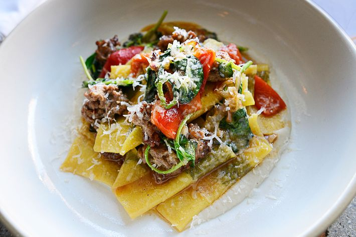 For his mint tacconi, Di Meglio encases the fresh herb in thinly rolled pasta and sauces it with lamb sausage, peppers, eggplant, and watercress.