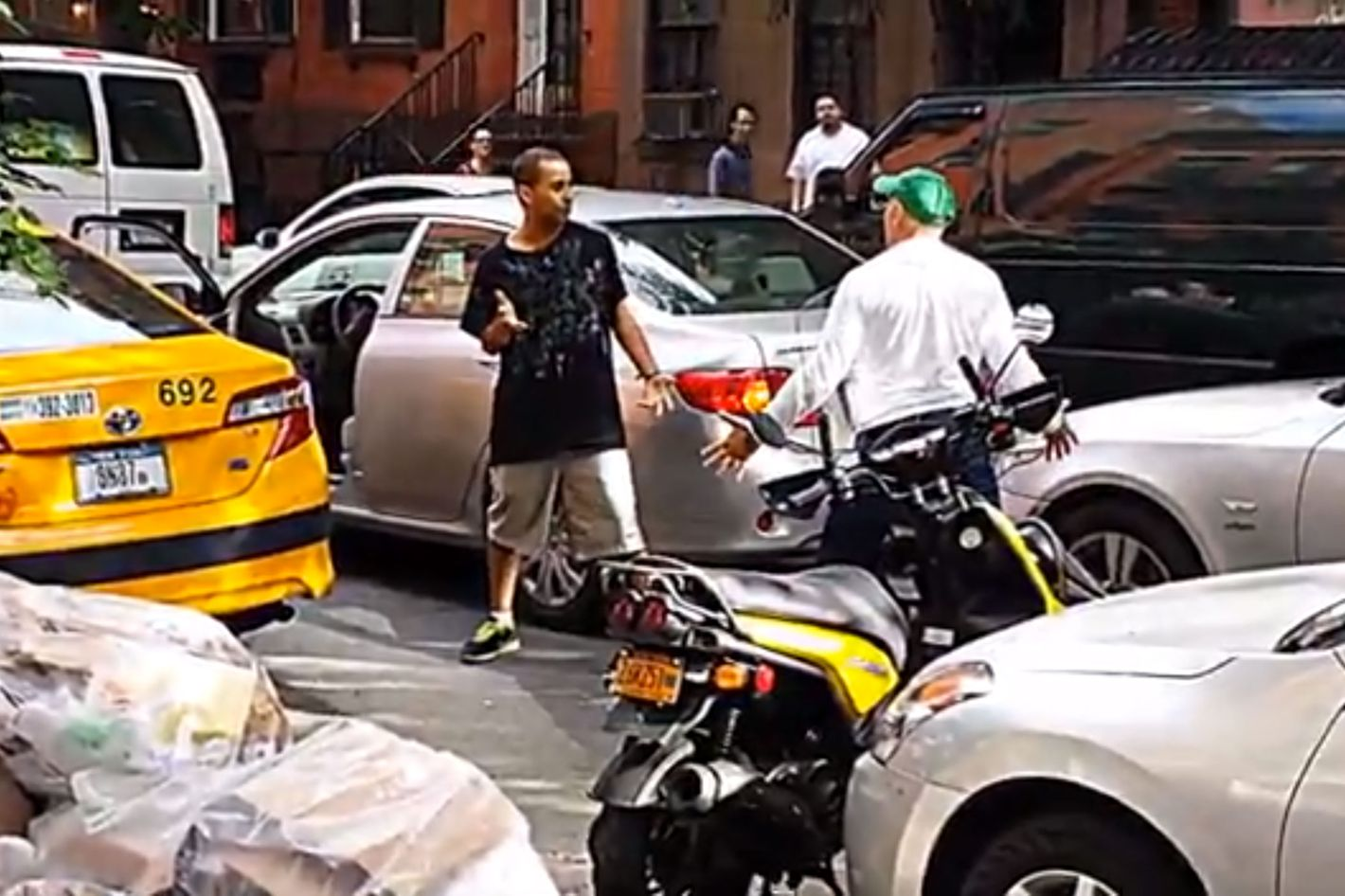 In Which Two Child-Men Box Each Other in the Street Over a Parking Spot [Updated]