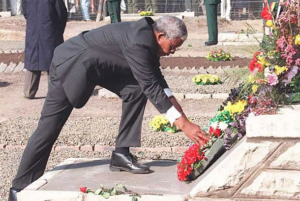 South African president Nelson Mandela lays a wreath at the Thibella cemetry in Maseru on the graves of ANC actvists killed in Lesotho during SADF cross-border raids between 1982 and 1985. This is Mandela's first state visit to the mountain kingdom.