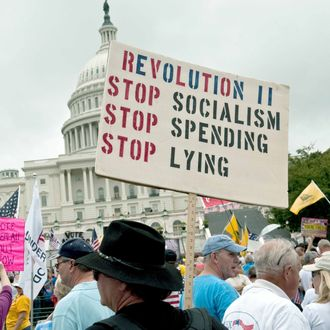 A demonstrator carries a sign calling for a second American revolution to bring an end to alleged Socialism, spending and lying in front of the US Capitol during a march by supporters of the conservative Tea Party movement in Washington on September 12, 2010.