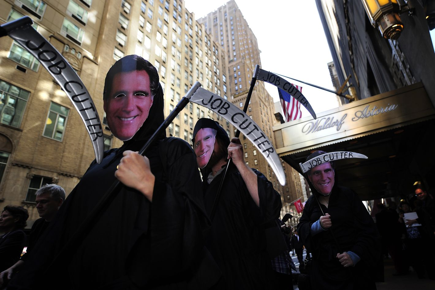 Occupy Wall Street protesters, dressed as billionaires, stage a demonstration against US Republican presidential candidate Mitt Romney in front of the Waldorf Astoria hotel as Romney holds a campaign fundraiser inside the hotel, in New York, March 14, 2012. AFP PHOTO/Emmanuel Dunand (Photo credit should read EMMANUEL DUNAND/AFP/Getty Images)