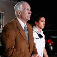 BELLEFONTE, PA - JUNE 22:  Former Penn State assistant football coach Jerry Sandusky leaves the Centre County Courthouse in handcuffs after a jury found him guilty in his sex abuse trial on June 22, 2012 in Bellefonte, Pennsylvania. The jury found Sandusky guilty on 45 of 48 counts in the sexual abuse trial of the former Penn State assistant football coach, who was charged with sexual abuse of 10 boys over a 15-year period.  (Photo by Rob Carr/Getty Images)