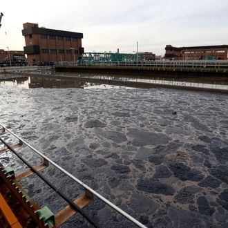 Wastewater sits inside of a partially operating treatment tank at the Passaic Valley Sewerage Commission, Thursday, Nov. 15, 2012, in Newark, N.J. The state's largest wastewater treatment plant suffered a complete power outage during Superstorm Sandy and pumped hundreds of millions of gallons of untreated and partially treated waste into New Jersey's waterways.