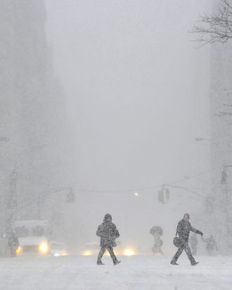 A view down 5th Avenue in the snow as New Yorkers get hit with a winter storm in the Northeast January 21, 2014 that could bring up to a foot (30 cm) of snow in the city. AFP PHOTO / TIMOTHY CLARY (Photo credit should read TIMOTHY A. CLARY/AFP/Getty Images)