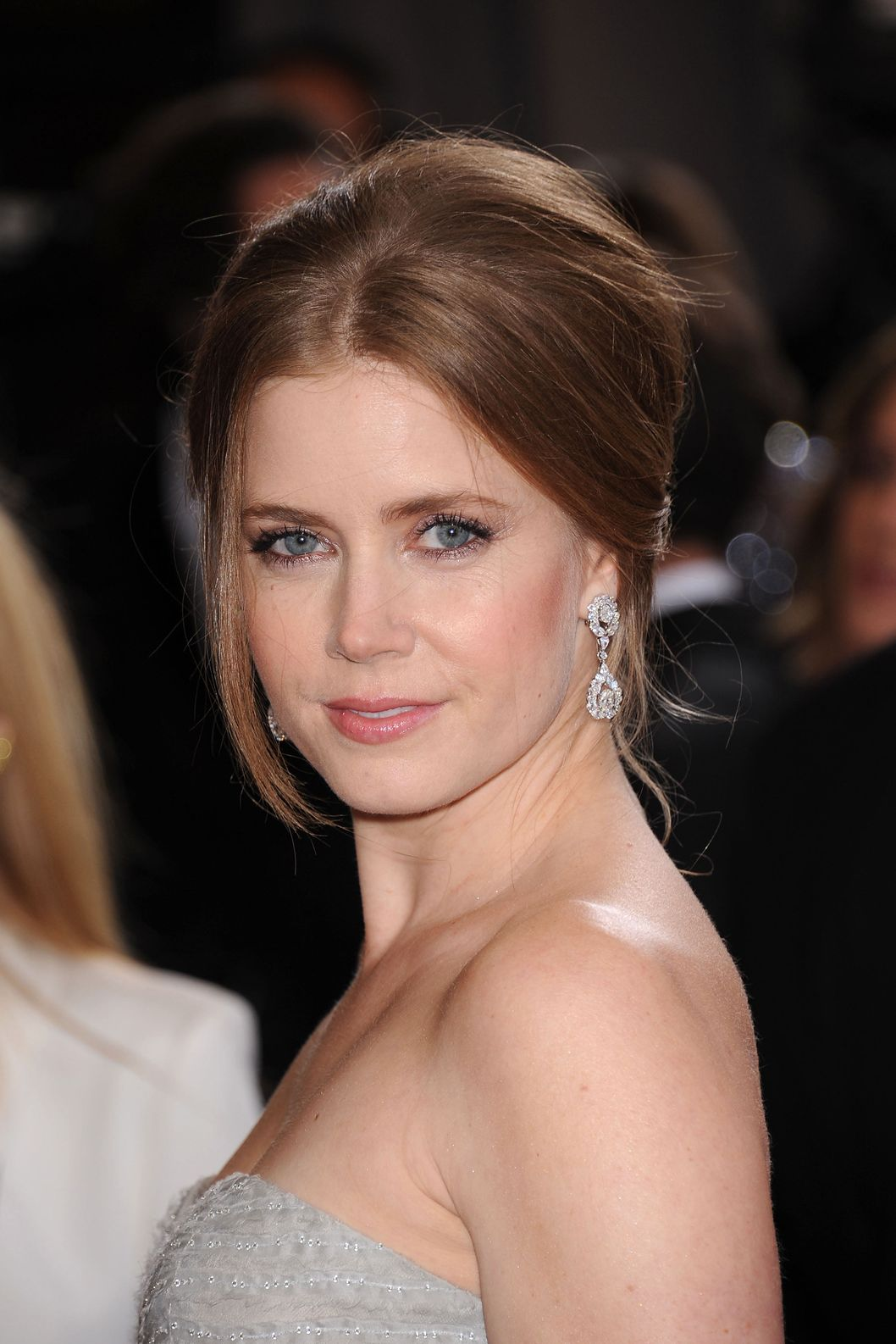Feb. 24, 2013 - Los Angeles, California, U.S. - AMY ADAMS, nominated for best actress in a supporting role, wears a strapless Oscar de la Renta gown and Moa jewelry as she arrives on the red carpet for the 85th Academy Awards at the Dolby Theatre.