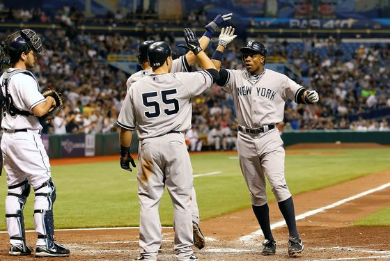 ST. PETERSBURG, FL - MAY 16:  Outfielder Curtis Granderson #14 of the New York Yankees is congratulated by Derek Jeter #2 and Russell Martin #55 after this fifth inning three run home run against the Tampa Bay Rays during the game at Tropicana Field on May 16, 2011 in St. Petersburg, Florida.  (Photo by J. Meric/Getty Images)