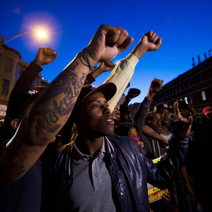 28 Apr 2015, Baltimore, Maryland, USA --- Protestors gather Tuesday, April 28, 2015, in Baltimore. Maryland's governor vowed there would be no repeat of the looting, arson and vandalism that erupted Monday in some of the city's poorest neighborhoods. (AP Photo/Matt Rourke) --- Image by ? Matt Rourke/AP/Corbis