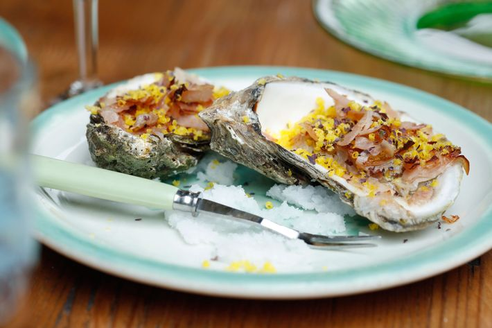 Baked oysters with seaweed brown butter, prosciutto cotto, egg, and leeks.