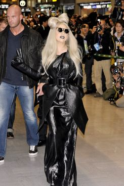 US pop singer Lady Gaga reacts to Japanese fans upon her arrival at the Narita International Airport, suburdan Tokyo on December 20, 2011. Gaga is now here to perform at a Japanese television's music program.
