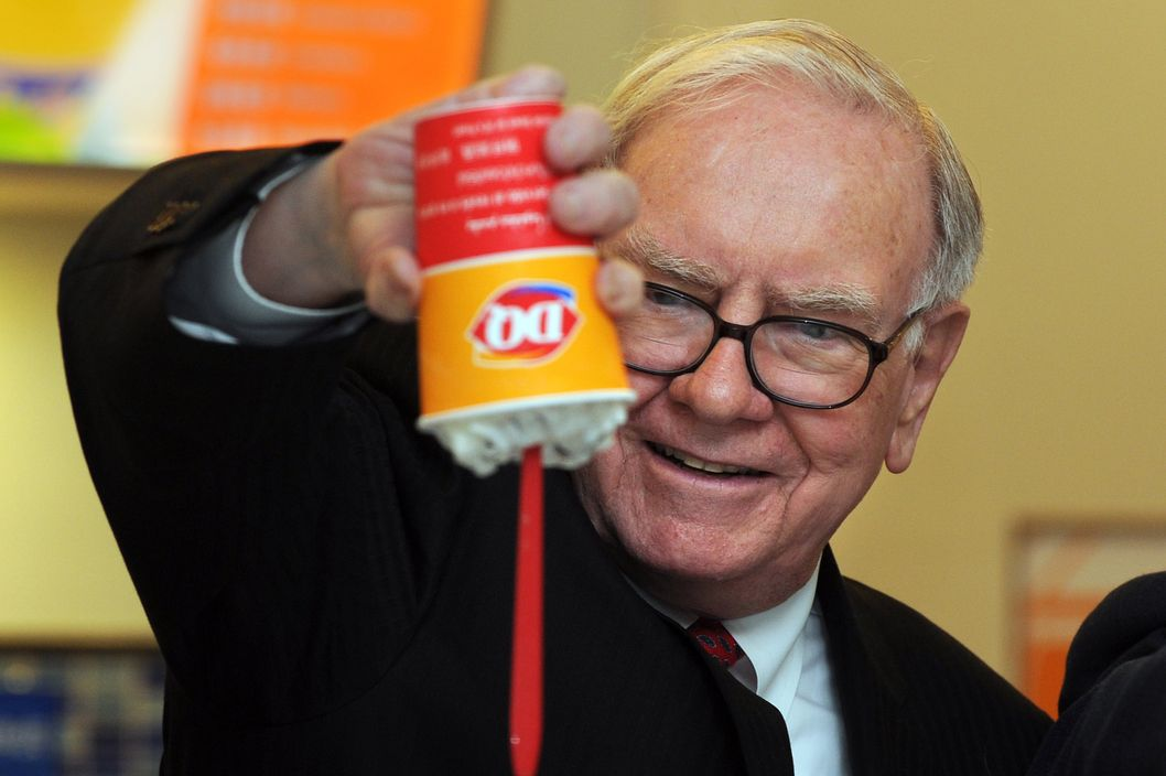 US billionaire investor Warren Buffett flips over a Dairy Queen Blizzard treat, the most successful product ever released in the history of Dairy Queen, a US desert chain with over 300 stores in China, at the opening of a new branch in Beijing on September 30, 2010.  Bill Gates and Buffett hosted a banquet the previous night for China's super rich that sparked debate about Chinese philanthropy, amid reports that wealthy invitees had been reluctant to attend. The two, who have already persuaded 40 wealthy US individuals to hand over more than half of their fortunes, had insisted they would not pressure attendees for money and simply wanted to learn about charity in China. Buffett is the CEO of Berkshire Hathaway which owns Dairy Queen. AFP PHOTO/Frederic J. BROWN (Photo credit should read FREDERIC J. BROWN/AFP/Getty Images)