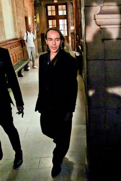 Galliano arriving at court today.