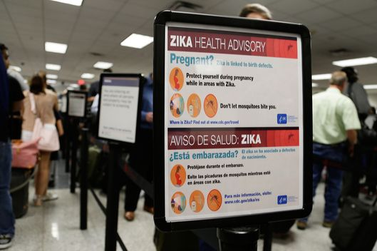 A Zika virus sign is seen at Hartsfield–Jackson Atlanta International Airport, Monday, May 9, 2016, in Atlanta.  (AP Photo/Mike Stewart)
