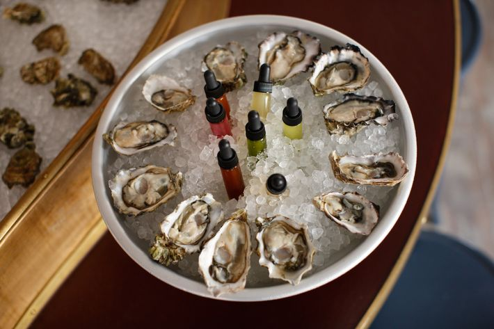 East Coast oysters with accouterments: classic mignonettes, cocktail sauce, green curry, jerk sauce, and citrus.