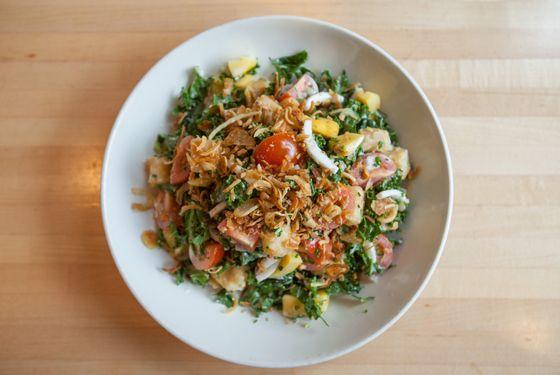 Kin Shop's kale salad with jackfruit and crispy tofu.