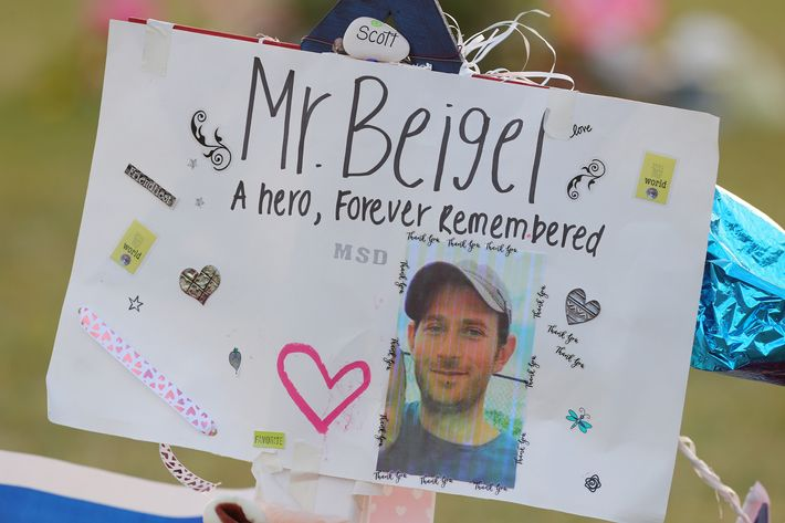 A memorial sign for Scott Beigel at Pine Trails Park in Parkland, Florida.