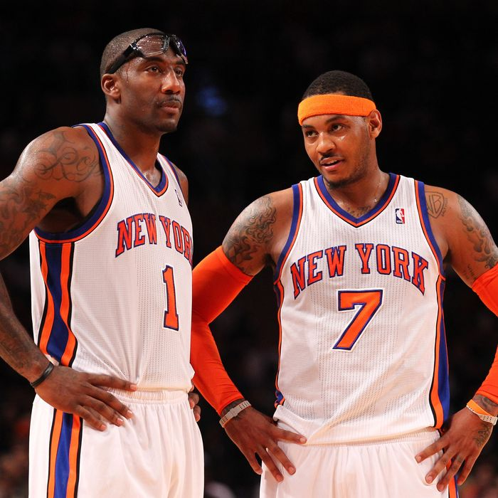 Amare Stoudemire #1 , and Carmelo Anthony #7 of the New York Knicks talk during their pre season game against the New Jersey Nets.