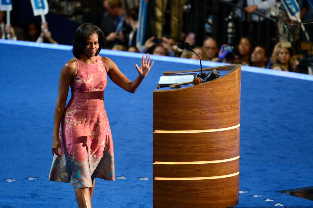 First Lady Michelle Obama waves to the delegates after finishing her speech at the 2012 Democratic National Convention in Charlotte, North Carolina, Tuesday, September 4, 2012. (Adam Jennings/Charlotte Observer/MCT)