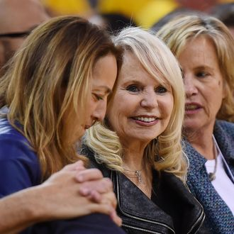 OAKLAND, CA - APRIL 27: Shelly Sterling (C), the wife of Donald Sterling owner of the Los Angeles Clippers, watches the Clippers against the Golden State Warriors in Game Four of the Western Conference Quarterfinals during the 2014 NBA Playoffs at ORACLE Arena on April 27, 2014 in Oakland, California. The players wore theirs warm up this way in protest of owner Donald Sterling's racially insensitive remarks. NOTE TO USER: User expressly acknowledges and agrees that, by downloading and or using this photograph, User is consenting to the terms and conditions of the Getty Images License Agreement. (Photo by Thearon W. Henderson/Getty Images)