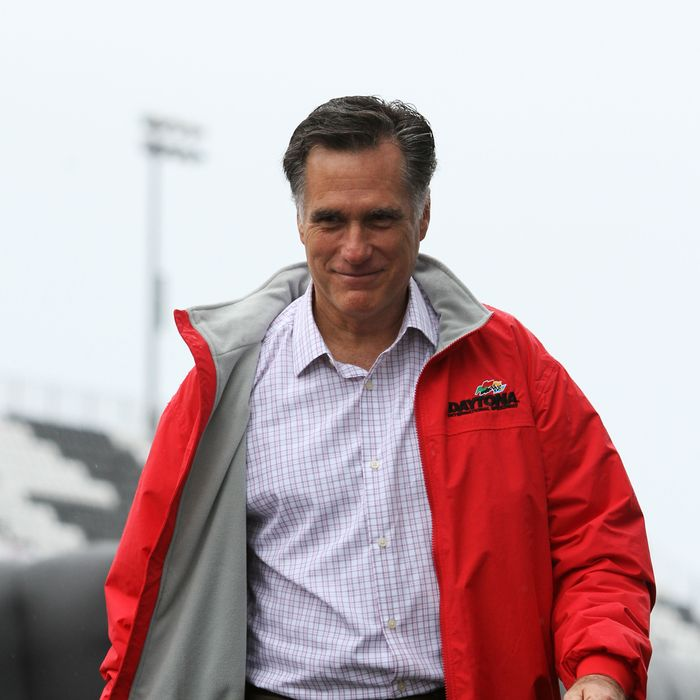 DAYTONA BEACH, FL - FEBRUARY 26: Republican presidential candidate, former Massachusetts Gov. Mitt Romney walks away after speaking during driver introductions for the NASCAR Sprint Cup Series Daytona 500 at Daytona International Speedway on February 26, 2012 in Daytona Beach, Florida. (Photo by Jerry Markland/Getty Images for NASCAR)
