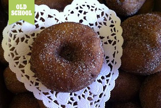 "<a href=""https://www.facebook.com/aBakersWife"">A Baker's Wife</a>    This no-frills shop is slightly kitschy in an endearing, Midwestern way. Traditional signature flavors include thickly chocolate-frosted and cinnamon-sugar cake doughnuts, which are a steal at under $1. Bring cash.    <b>What to Order:</b> The cinnamon-sugar cake doughnut."