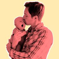 Father kissing baby son (2-5 months)