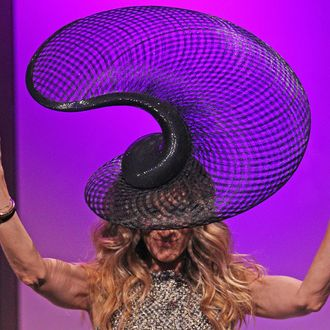 Sarah Jessica Parker wears a hat designed by Philip Treacy as she waves to the audience at the VRC Oaks Club Ladies Luncheon at Crown Palladium on November 2, 2011 in Melbourne, Australia.