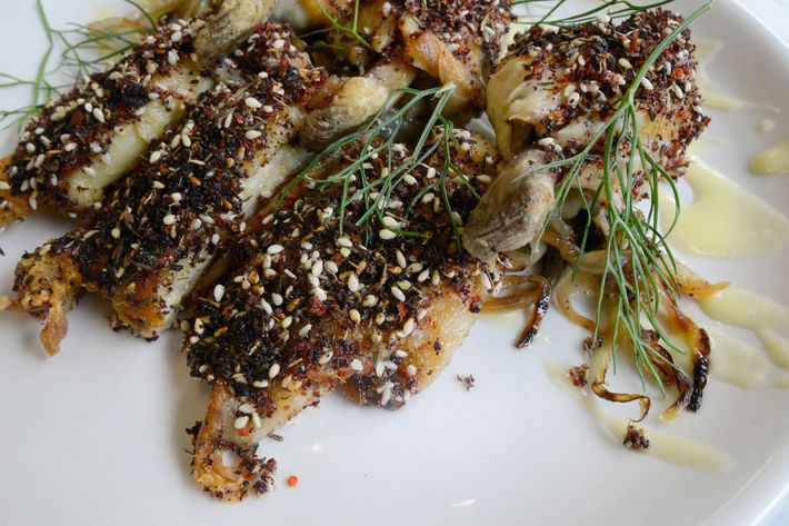 Confited chicken wings, topped with seeds and spices and garnished with caramelized fennel and fronds.