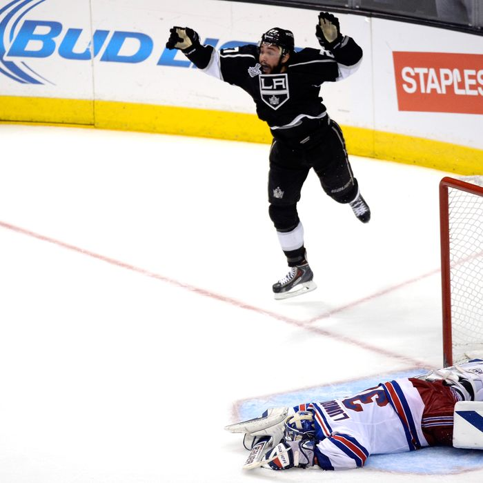 LOS ANGELES, CA - JUNE 13: Alec Martinez #27 of the Los Angeles Kings celebrates after scoring the game-winning goal in double overtime against Henrik Lundqvist #30 of the New York Rangers during Game Five of the 2014 Stanley Cup Final at Staples Center on June 13, 2014 in Los Angeles, California. (Photo by Kevork Djansezian/Getty Images)