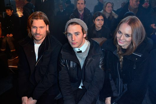 NEW YORK, NY - FEBRUARY 10:  (L-R) Actors Nikolaj Coster-Waldau, Sam Claflin, and Laura Haddock attend the Y-3 show during Fall 2013 Mercedes-Benz Fashion Week on February 10, 2013 in New York City.  (Photo by Brian Killian/WireImage)