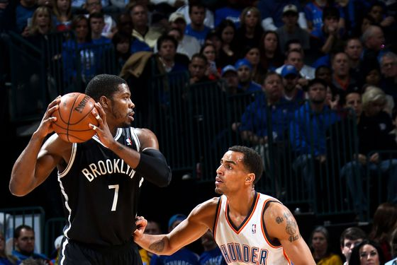 Joe Johnson #7 of the Brooklyn Nets controls the ball against Thabo Sefolosha #2 of the Oklahoma City Thunder on January 2, 2013 at the Chesapeake Energy Arena in Oklahoma City, Oklahoma.