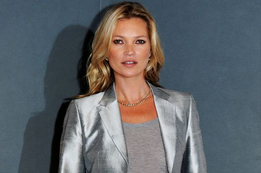 Kate Moss poses at a photocall ahead of the 'Kate Moss: The Collection' auction which sees various artworks of the model curated by Gert Elfering go under the hammer at Christie's King Street on September 4, 2013 in London, England.