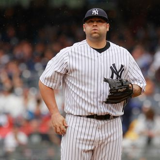 Joba Chamberlain #62 of the New York Yankees reacts to the action in the seventh-inning against the Baltimore Orioles at Yankee Stadium on August 1, 2012 in the Bronx borough of New York City.