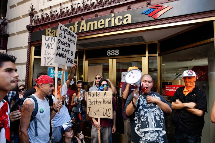 Protesters stop to demonstrate outside a Bank of America branch in Los Angeles, California.