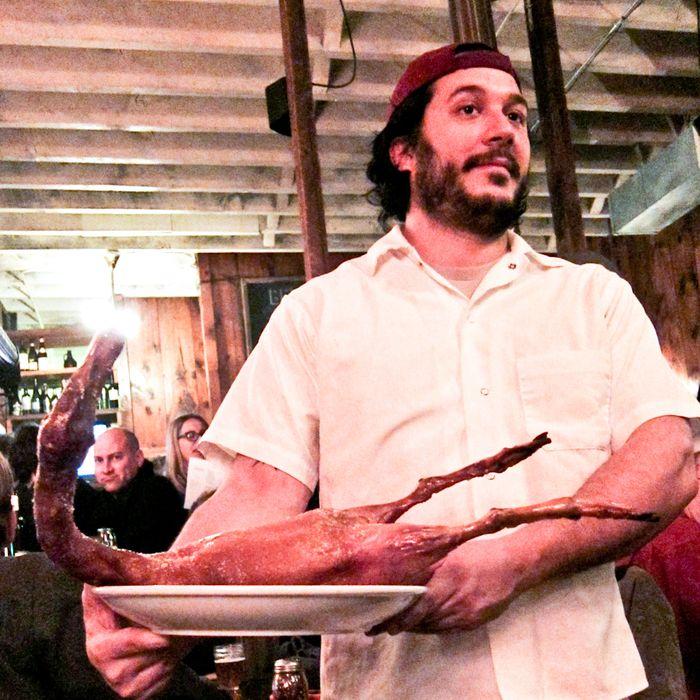 Mirarchi serves a roast duck.