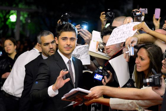 "TORONTO, ON - SEPTEMBER 09:  Zac Efron signs autographs at the ""At Any Price"" premiere during the 2012 Toronto International Film Festival at the Princess of Wales Theatre on September 9, 2012 in Toronto, Canada.  (Photo by Mark Davis/Getty Images)"