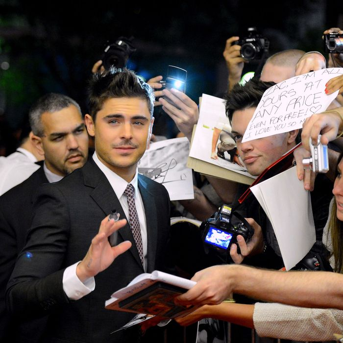 Zac Efron signs autographs at the