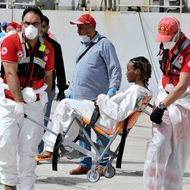 "A woman rescued at sea receives medical assistance as the Italian Navy ship ""Vega"" arrives with more than 600 migrants and refugees on May 29, 2016 in the port of Reggio Calabria, southern Italy."