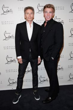 Designer Calvin Klein and model Nick Gruber attend the Christian Louboutin Cocktail party at Barneys New York on November 1, 2011 in New York City.