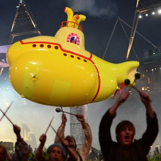 An inflatable yellow submarine floats above artists performing during the opening ceremony of the London 2012 Olympic Games on July 27, 2012 at the Olympic stadium in London.