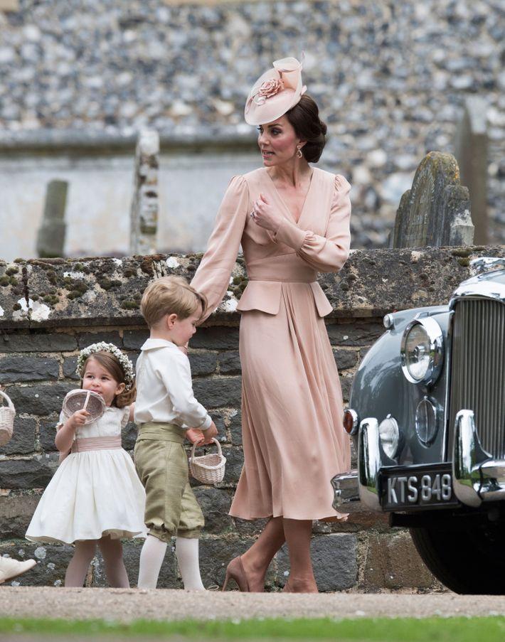 Princess Charlotte, Prince George, and Kate Middleton at Pippa Middleton's wedding.
