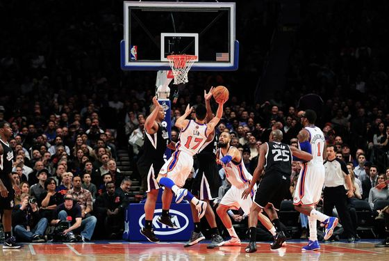 NEW YORK, NY - FEBRUARY 15: Jeremy Lin #17 of the New York Knicks shoots against the Sacramento Kings at Madison Square Garden on February 15, 2012 in New York City. NOTE TO USER: User expressly acknowledges and agrees that, by downloading and/or using this Photograph, user is consenting to the terms and conditions of the Getty Images License Agreement.  (Photo by Chris Trotman/Getty Images)