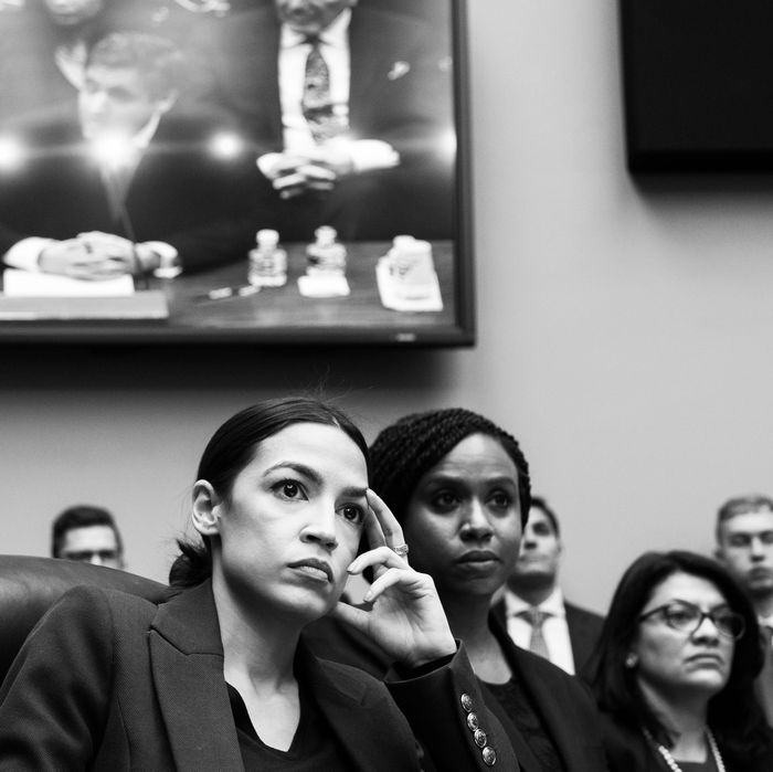 Alexandria Ocasio-Cortez, Ayanna Pressley and Rashida Tlaib during Michael Cohen's Congressional testimony.