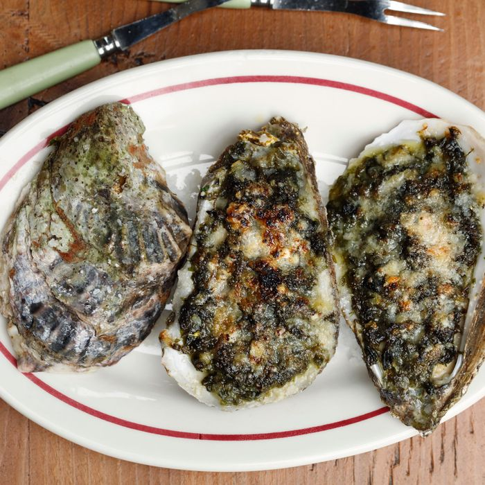 Broiled oysters with sea lettuce, spring onion, and Parmesan.