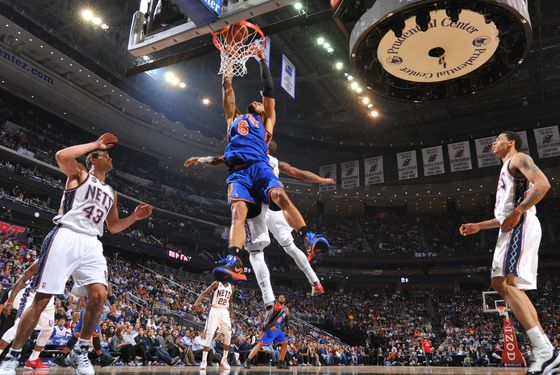 NEWARK, NJ - APRIL 18:  Tyson Chandler #6 of the New York Knicks dunks over Kris Humphries #43 of the New Jersey Nets on April 18, 2012 at the Prudential Center in Newark, New Jersey.  NOTE TO USER: User expressly acknowledges and agrees that, by downloading and/or using this Photograph, user is consenting to the terms and conditions of the Getty Images License Agreement. Mandatory Copyright Notice: Copyright 2012 NBAE   (Photo by Jesse D. Garrabrant/NBAE via Getty Images)